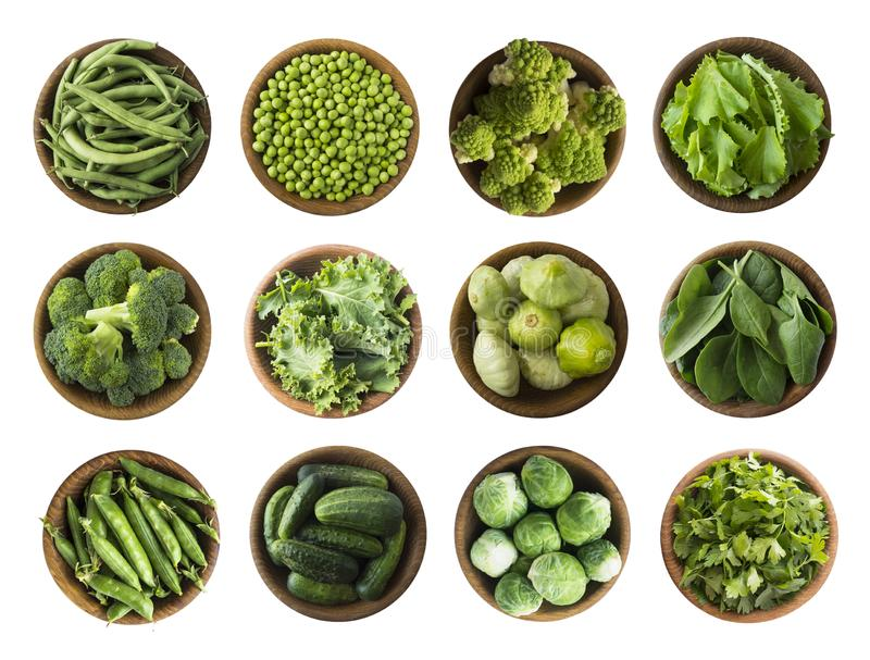 Vegetables isolated on a white. Squash, green peas, broccoli, kale leaves and green bean in wooden bowl. Vegetables with copy spac. E for text. Top view. Studio royalty free stock images