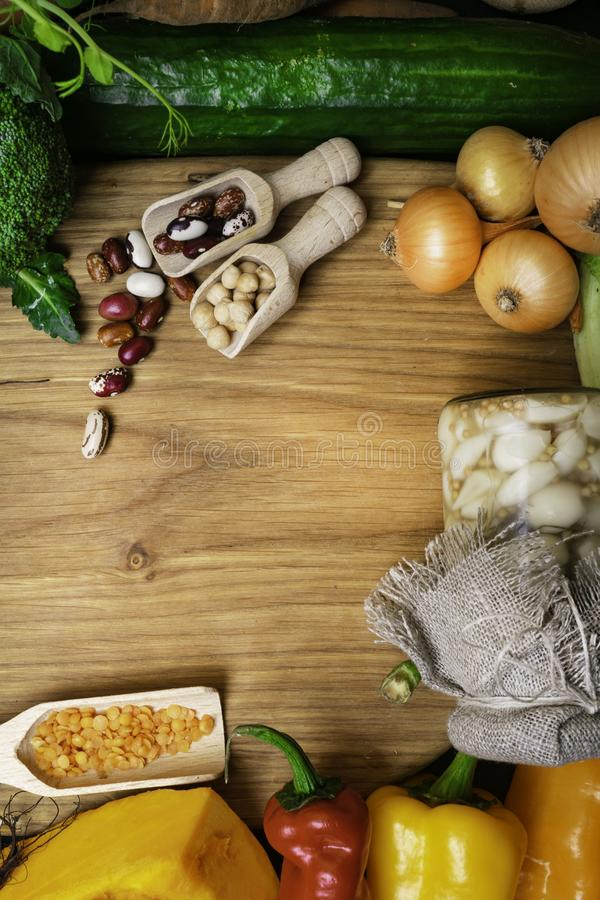 vegetables and legumes in wooden board. Organic food. Vegan food ingredients. Healthy eating concept royalty free stock photos