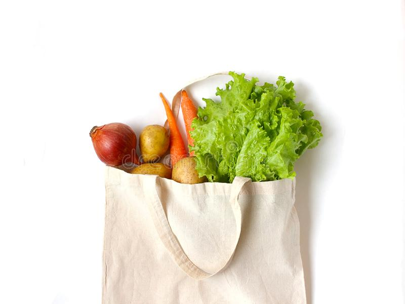 Vegetables in a linen bag for shopping. fresh ingredients for vegetarian dishes. Healthy nutrition and balanced diet. Zero waste stock photos