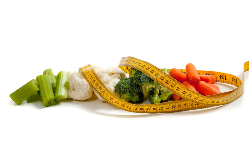 Vegetables with a measuring tape royalty free stock photo