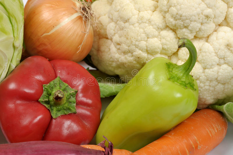 Vegetables mix 2. Fresh vegetables: green and red pepper, carrot, onion and cauliflower royalty free stock photo