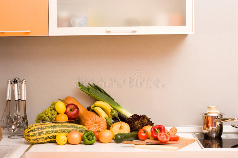 Vegetables in modern kitchen stock image
