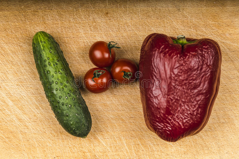 Vegetables on old board stock photos