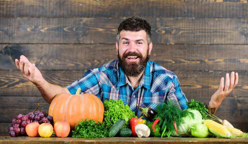 Vegetables organic harvest. Farmer rustic style guy. Natural foods. Vegetarian lifestyle concept. Man bearded farmer stock images