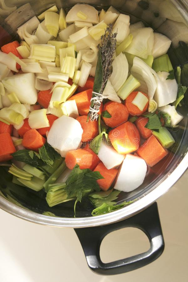 Vegetables for pot au feu in a cooking pot stock photography