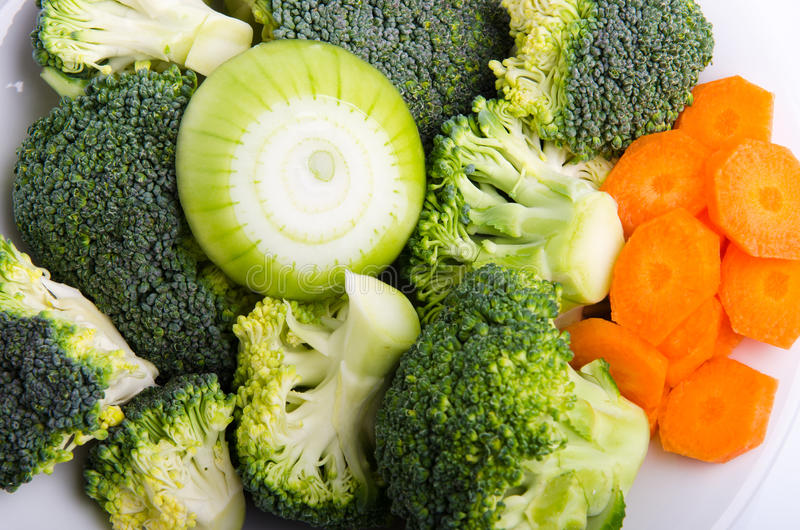 Vegetables. Raw vegetables with patatoes, onion and brocolo royalty free stock images