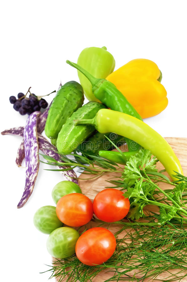 Vegetables with a round board stock image