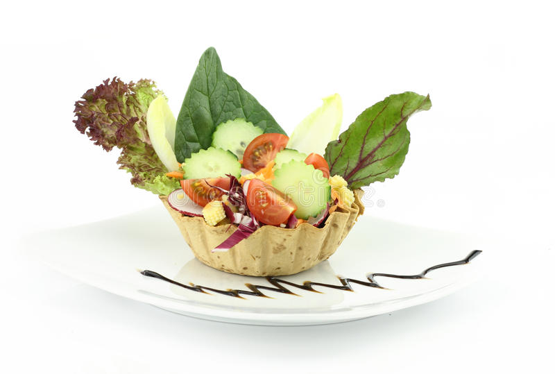 Vegetables salad. In the waffle bowl stock photography