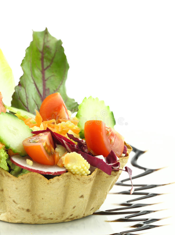 Vegetables salad. In the waffle bowl stock image