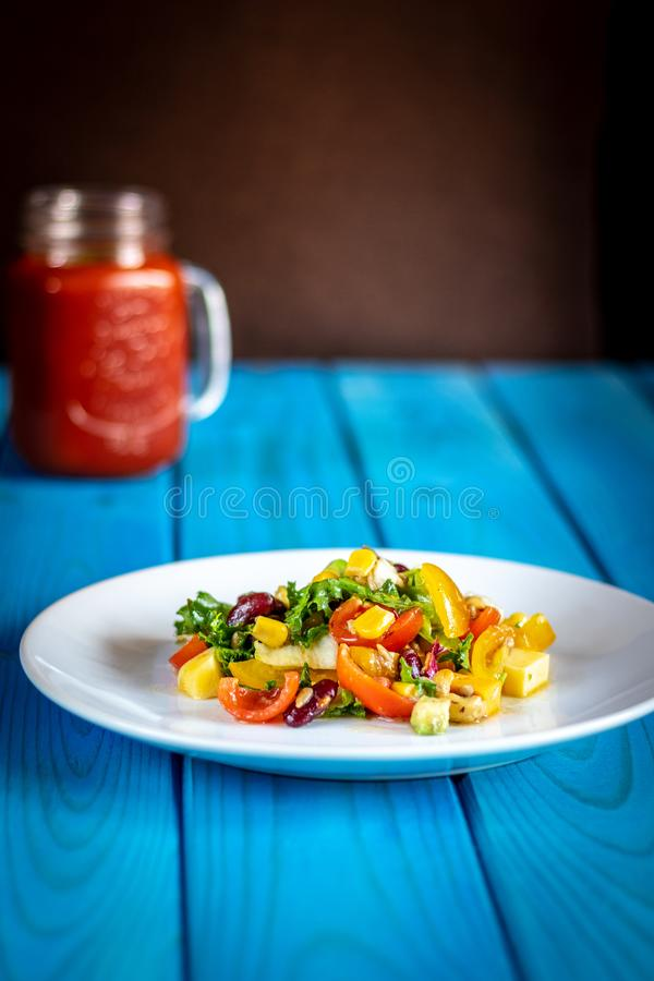 Vegetables salad on blue wooden table royalty free stock photo