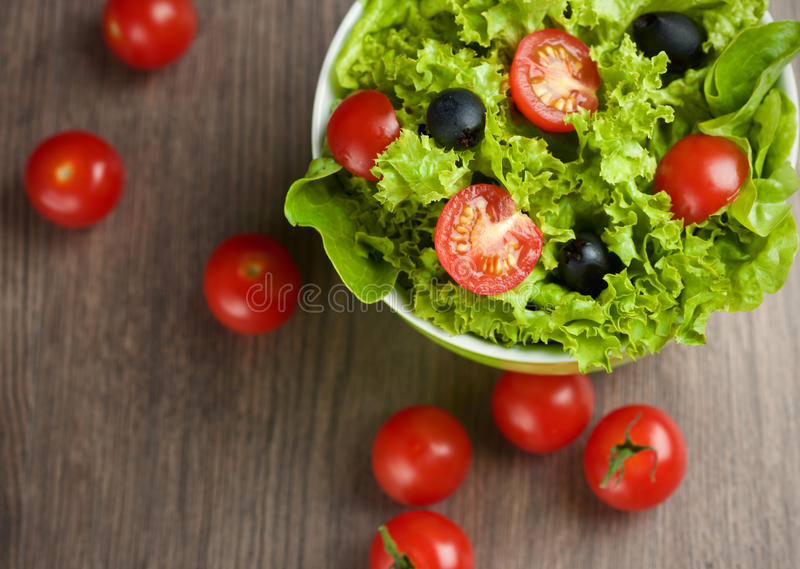 Vegetables salad. On wooden desk royalty free stock photos