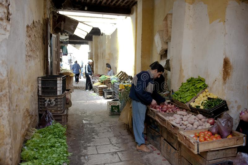Vegetables seller in Medina of Fez, Morocco royalty free stock images