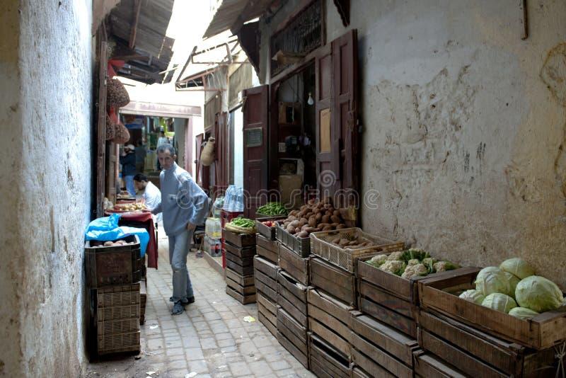 Vegetables seller in Medina of Fez, Morocco stock images