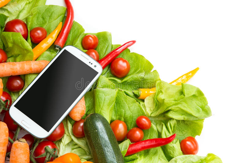 Vegetables and a Smartphone. Various vegetables with a Smartphone stock image