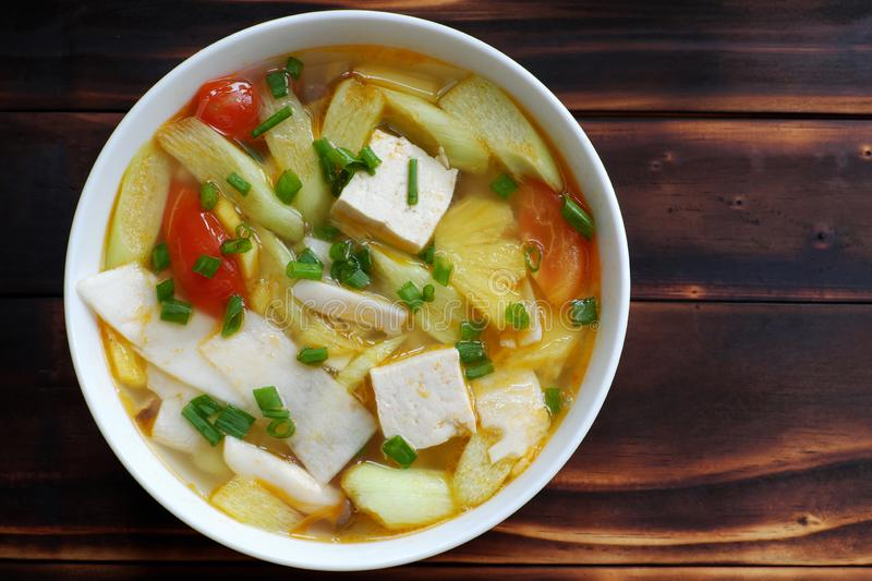 Vegetables soup from tomato, pineapple, bamboo shoot and tofu, mushroom stock photography