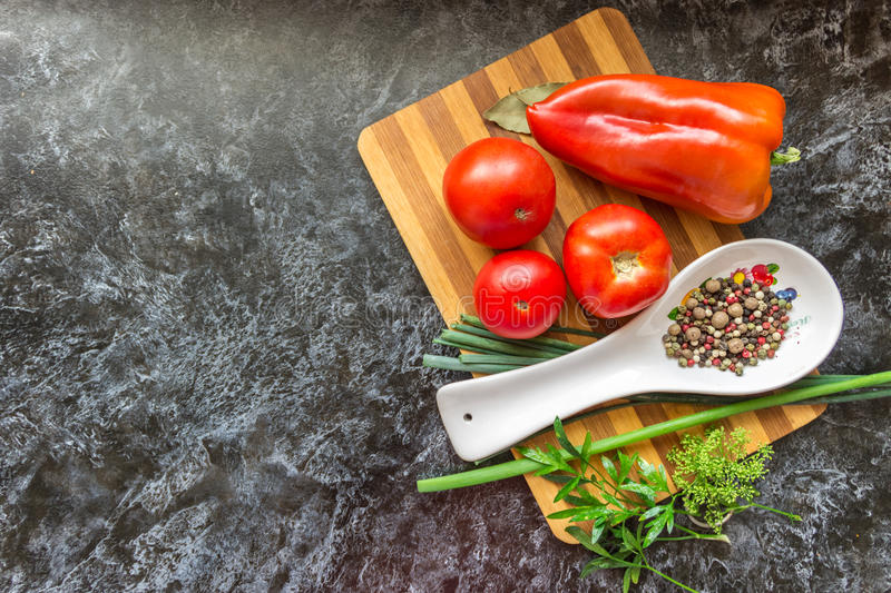 Vegetables and spices for cooking various dishes and a salad on stock photography