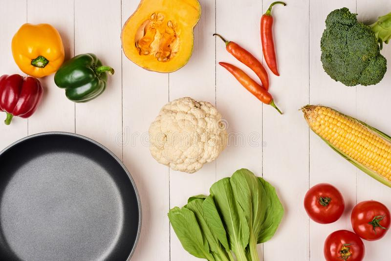 Vegetables and spices vintage border and empty frypan royalty free stock image