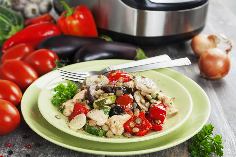 Vegetables, steamed with chicken and green lentils. Baked in the multiсooker royalty free stock photos
