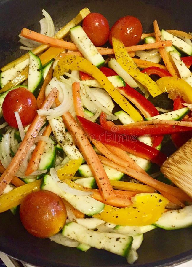 Vegetables stir fry. Healthy vegetables stir fry with tomatoes onion peppers carrots and zucchini royalty free stock photo