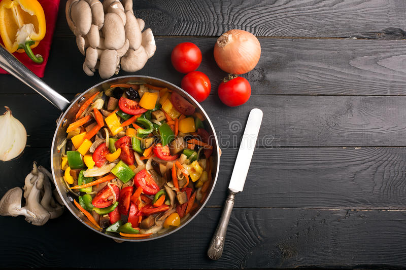 Vegetables stir fry. With oyster mushrooms and sauce royalty free stock image