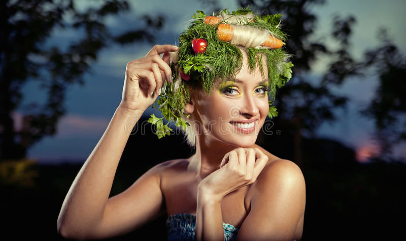 Vegetables-style portrait of a blond lady royalty free stock images