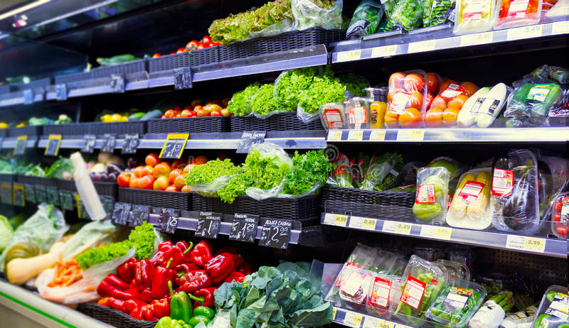 Vegetables at the supermarket. A view of a wide variety of fresh organic vegetables at a supermarket aisle royalty free stock photos
