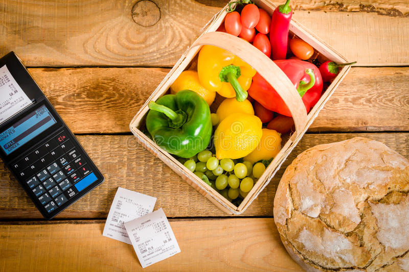 Vegetables on the table with a cash register royalty free stock photos