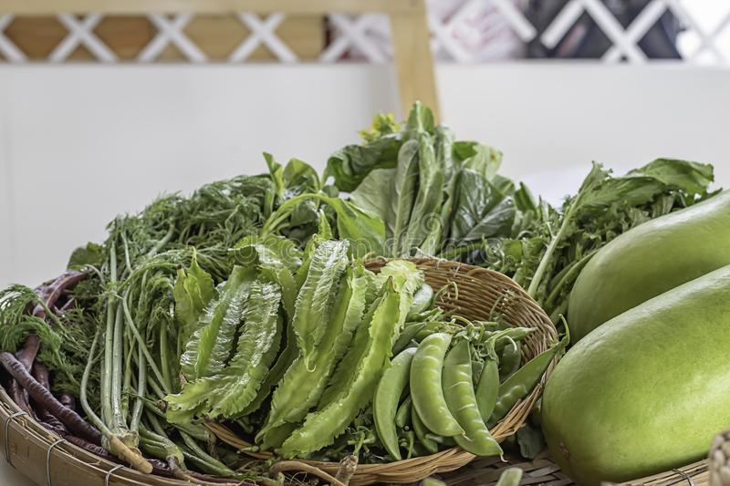 Vegetables in Thailand , Winged Bean , Peas and Winter melon in bamboo baskets stock image