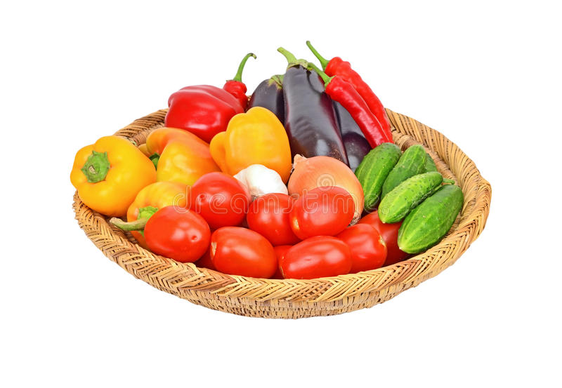 Vegetables in wattled basket royalty free stock photos