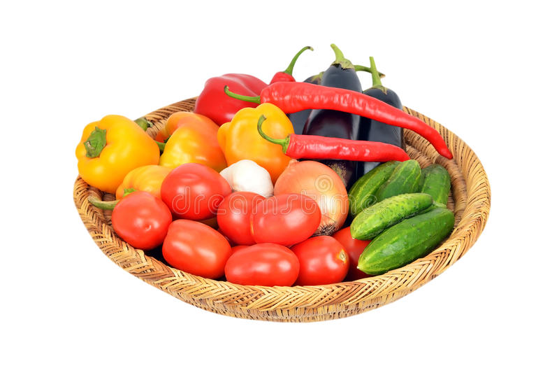 Vegetables in a wattled basket royalty free stock photography