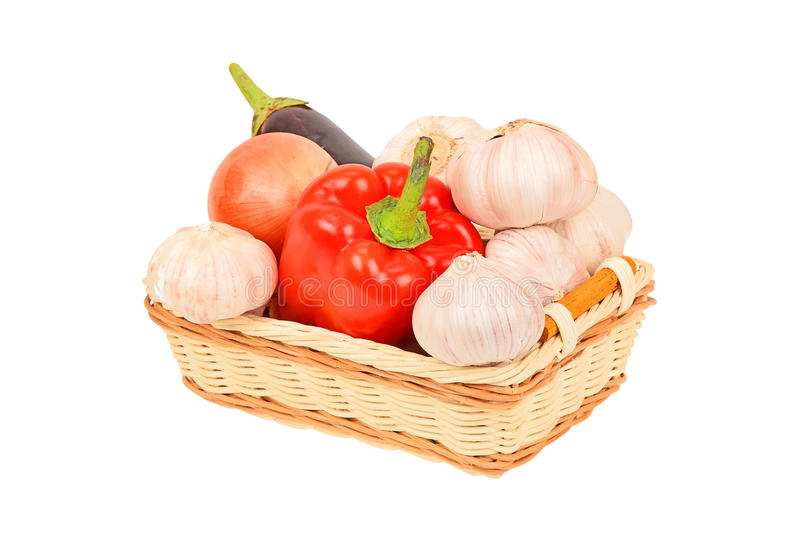 Vegetables in a wattled basket royalty free stock images