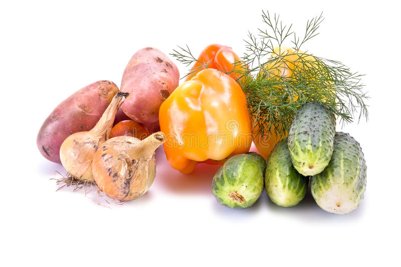 Vegetables on white. Many different vegetables are on a white background royalty free stock image