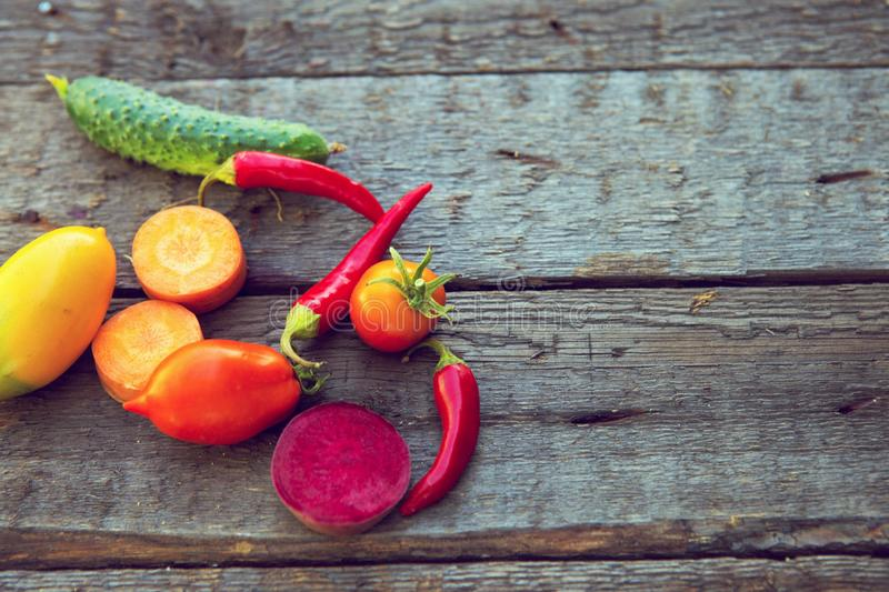 Vegetables on wood. Composition of fresh vegetables on a wooden table.  royalty free stock image