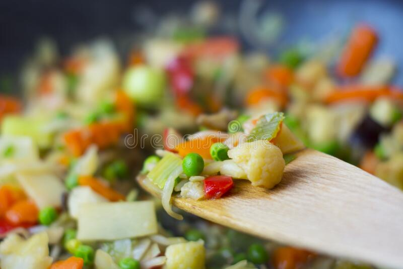 Vegetables on wooden spoon royalty free stock photo