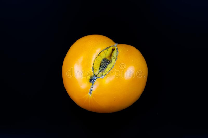 Vegetables yellow tomatoes on a black background stock image