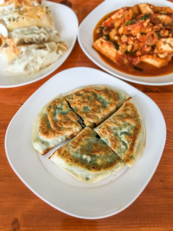 Vegetais de Koo Chai Chinese fritados foto de stock