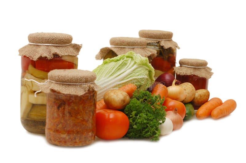 Vegetais frescos e estanhados imagens de stock