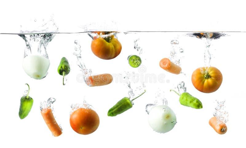 Vegetais na água imagem de stock royalty free