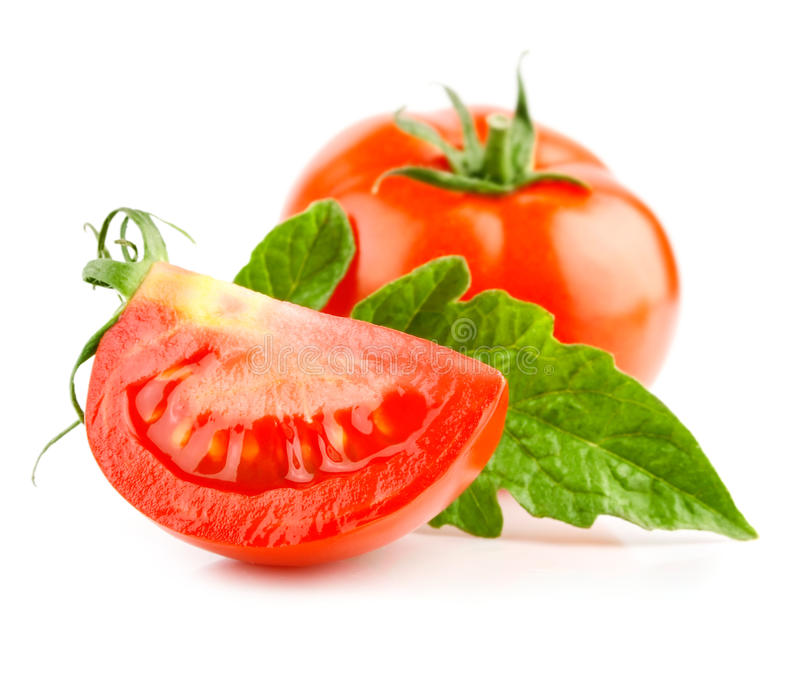 Vegetal vermelho do tomate com as folhas do corte e do verde foto de stock