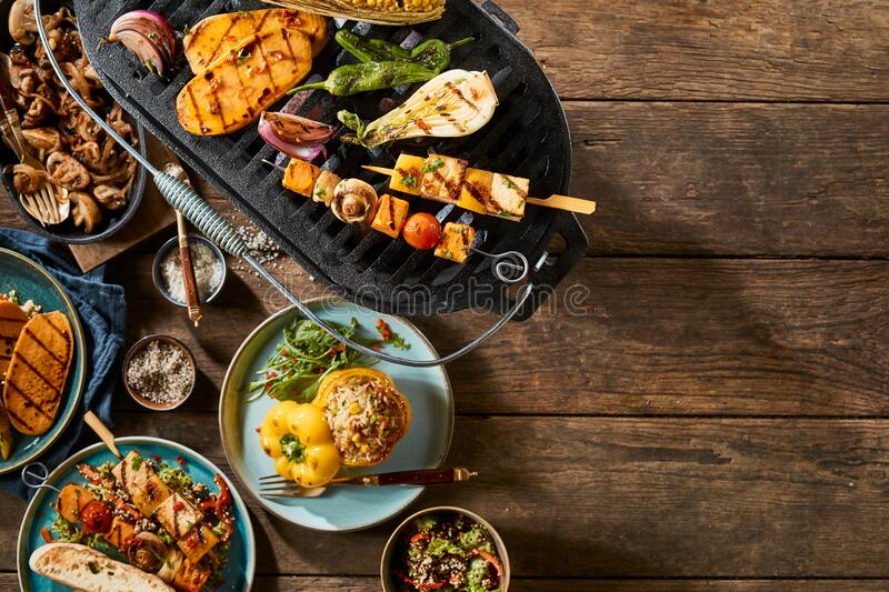 Vegetarian barbecue grill on rustic timber table royalty free stock photos