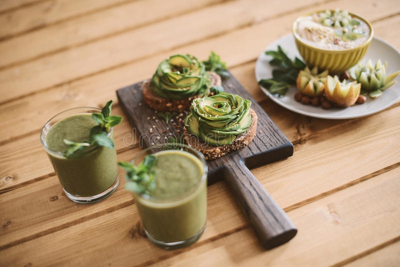 Vegetarian breakfast with avocado toasts and over homemade food royalty free stock images