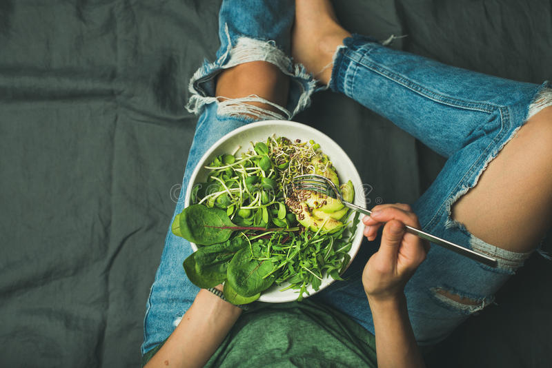 Vegetarian breakfast bowl with spinach, arugula, avocado, seeds and sprouts royalty free stock photo