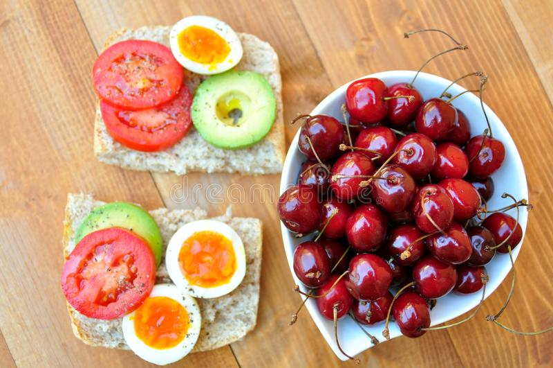 Vegetarian breakfast with fresh cherries royalty free stock photo