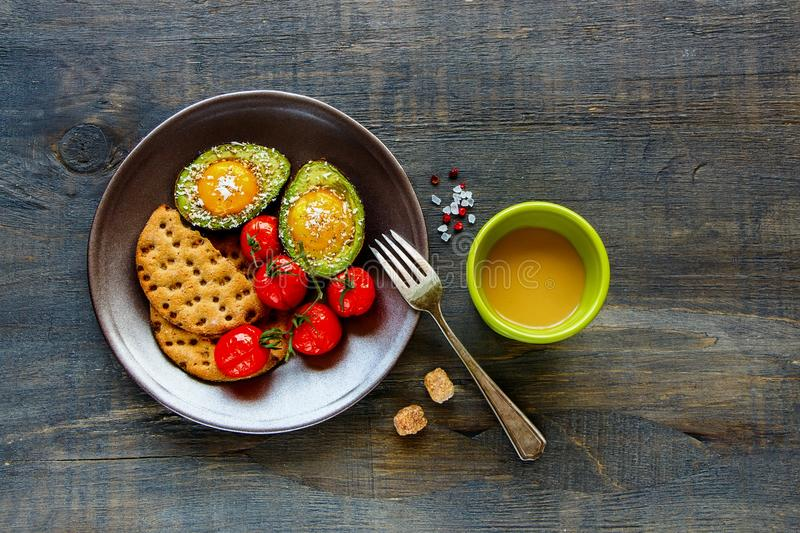 Avocado baked with eggs stock photography