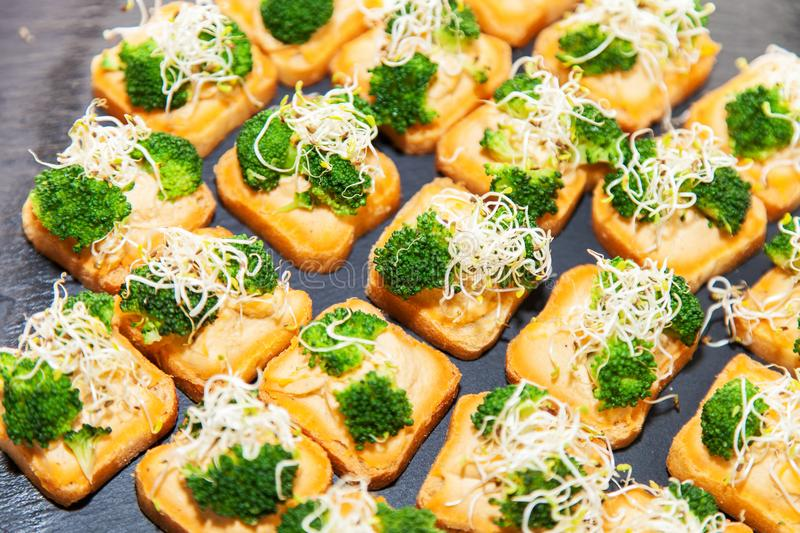Vegetarian canape with broccoli royalty free stock photos