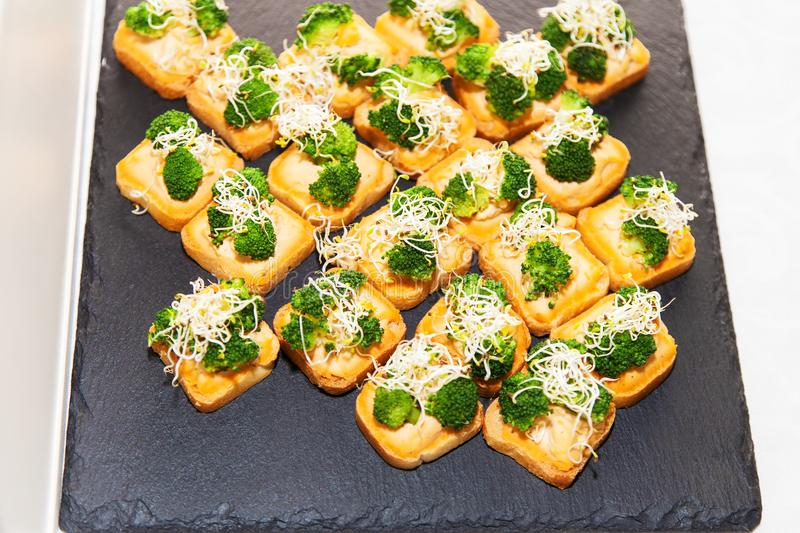 Vegetarian canape with broccoli royalty free stock photography