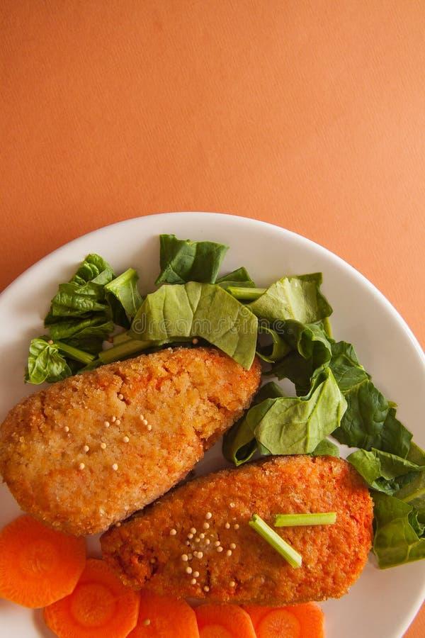 Vegetarian carrot pancakes stock images