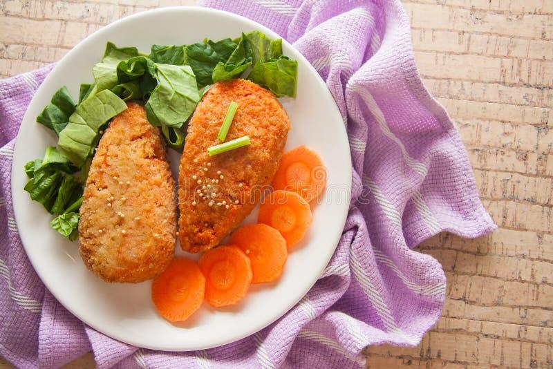 Vegetarian carrot pancakes royalty free stock images
