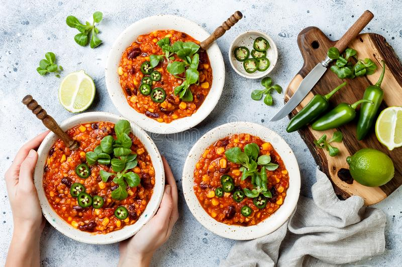 Vegetarian chili con carne with lentils, beans, lime, jalapeno. Mexican traditional dish. royalty free stock photography