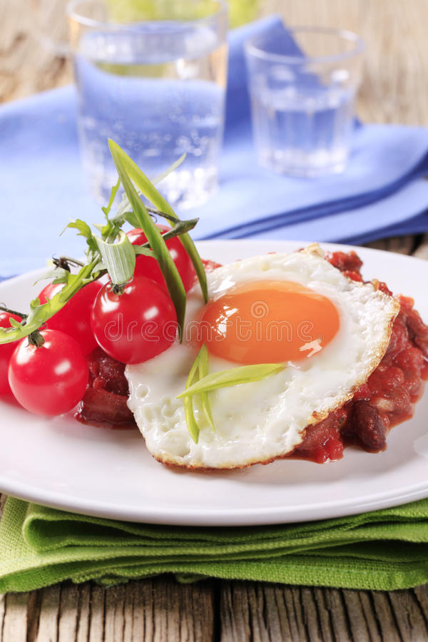 Vegetarian chili and fried egg stock photography